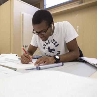 A landscape architecture student works on a design.