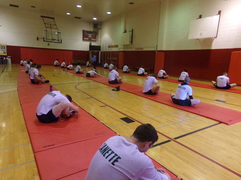 cadets stretching in the gym